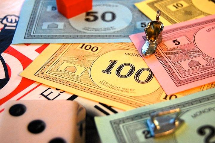 Economic Board Games: Monopoly and Real-Life Economics